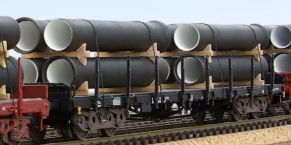 Rs flat wagons loaded with pipes